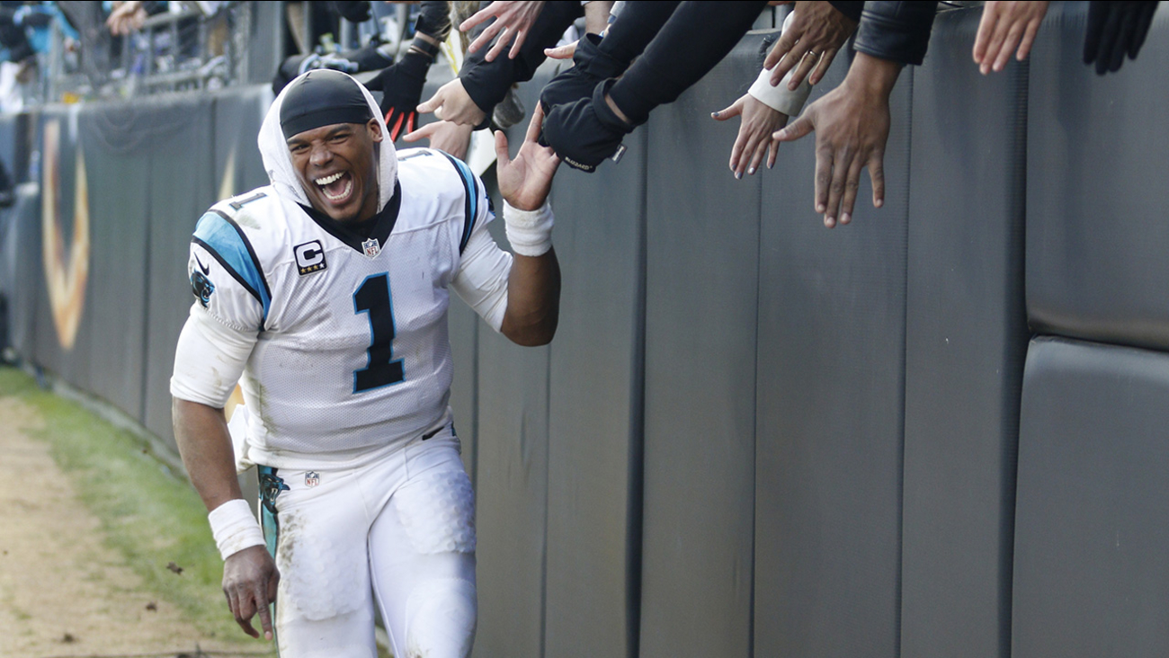Carolina Panthers quarterback Cam Newton celebrates with fans after the second half of an NFL divisional playoff football game against the Seattle Seahawks, Sunday, Jan. 17, 2016