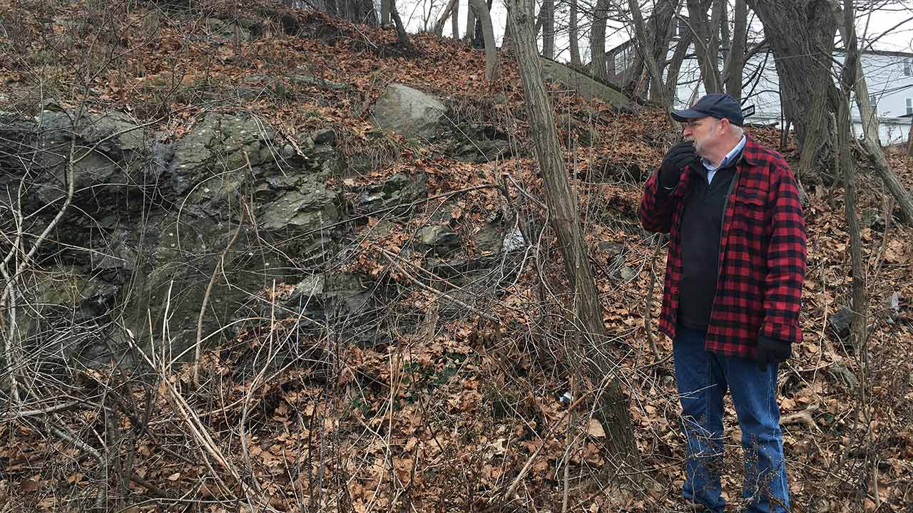 Salem State University history professor Emerson Baker at the exact site where 19 innocent people were hanged during the 1692 witch trials in Salem, Mass.