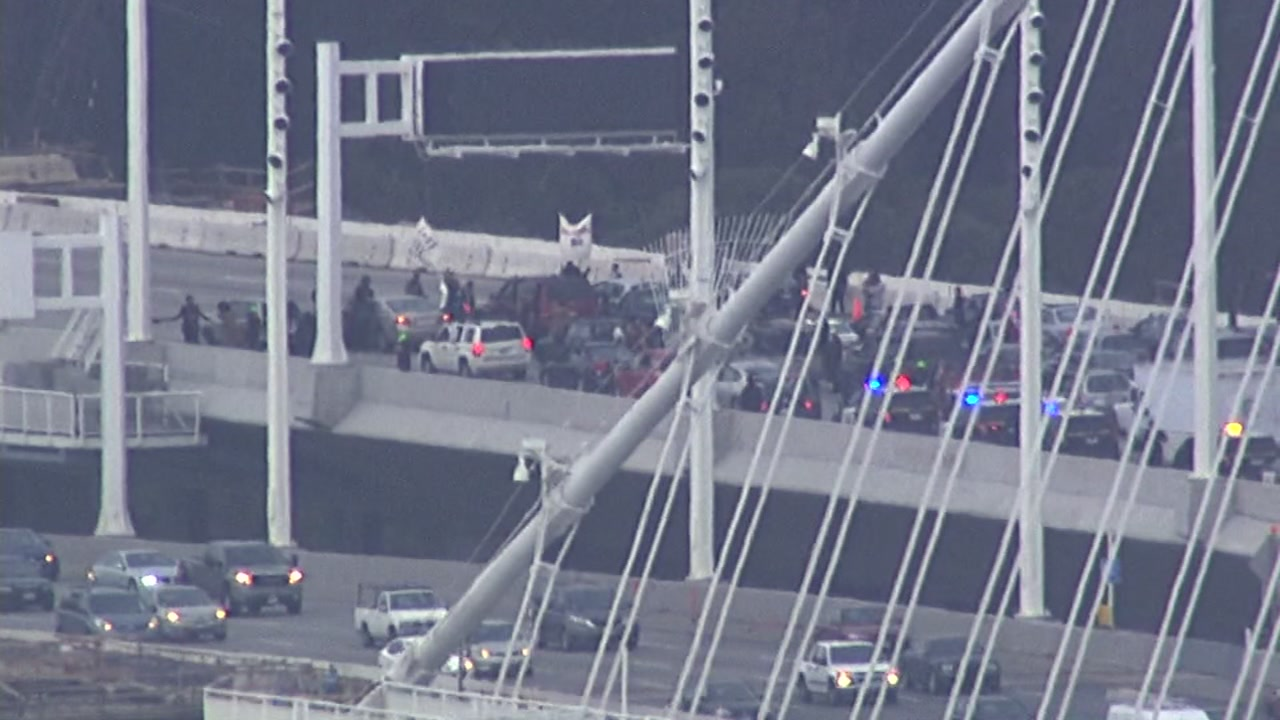 Protesters shut down traffic on the Bay Bridge just before Treasure Island on Monday, January 18, 2016.