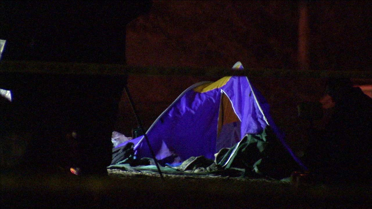 A tent is shown at the scene of a fatal shooting in the 4700 block of North Figueroa Street in Highland Park on Sunday, Jan. 18, 2016.