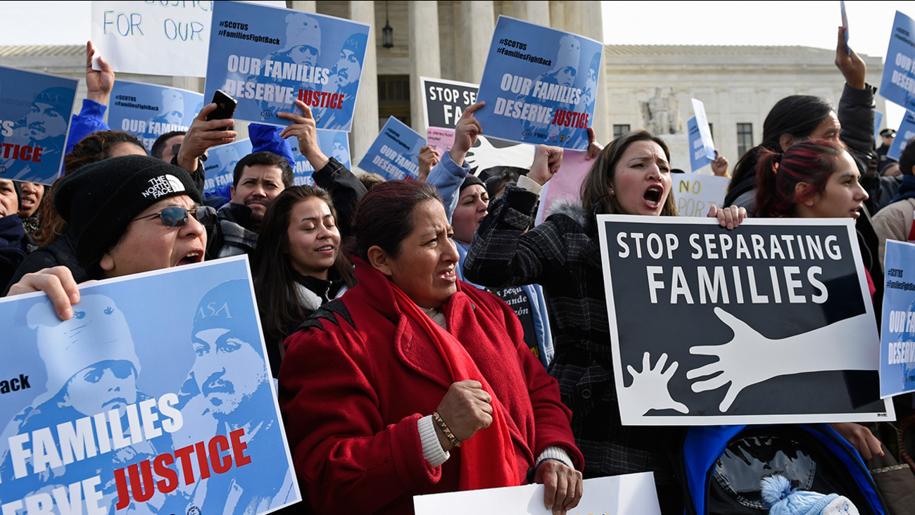 Members of CASA de Maryland participate in a immigration rally outside the Supreme Court in Washington, Friday, Jan. 15, 2016.
