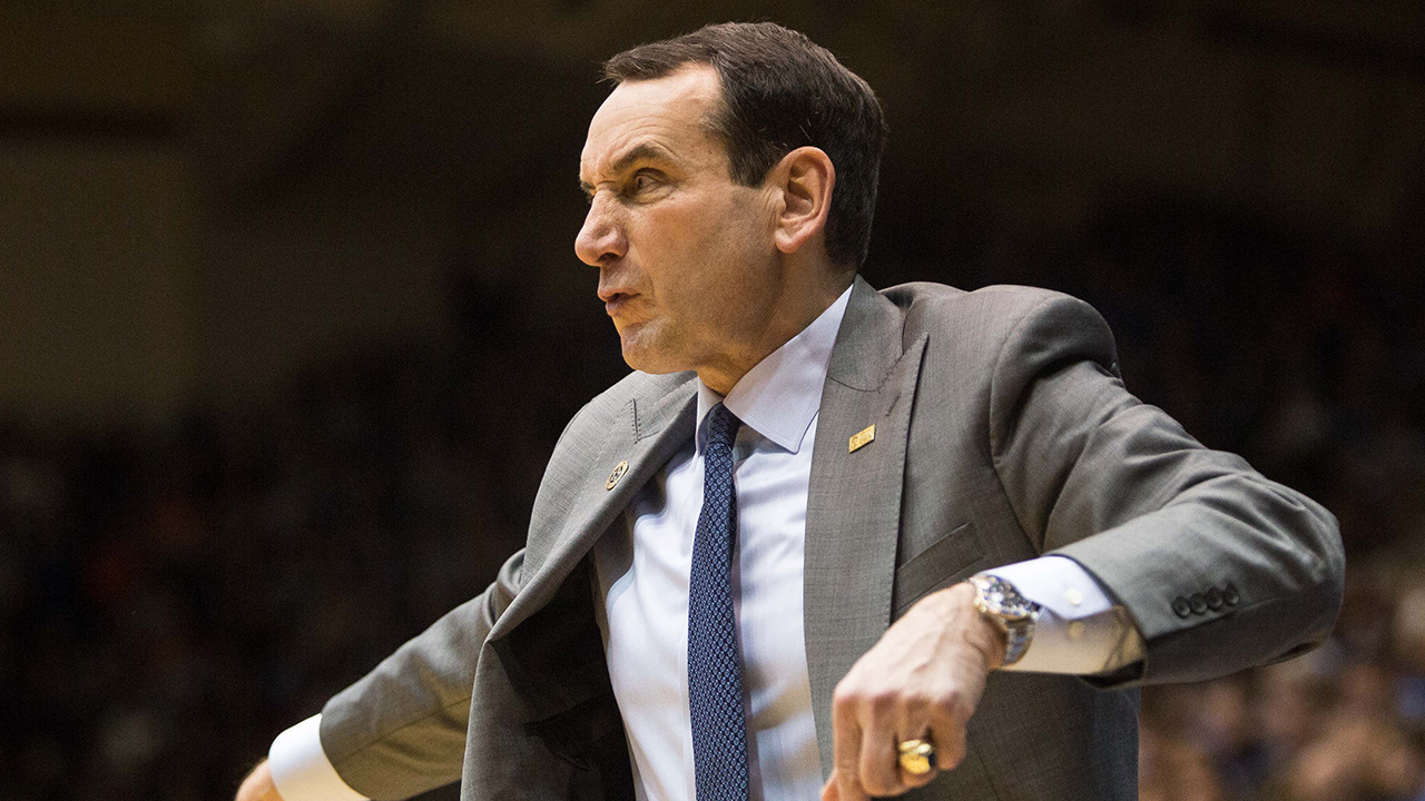 Duke head basketball coach Mike Krzyzewski shouts to the court during the second half of an NCAA college basketball game against Syracuse at Cameron Indoor Stadium in Durham, N.C.