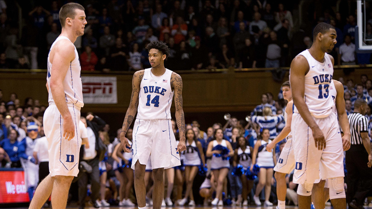 Duke's Marshall Plumlee, left, Brandon Ingram, Grayson Allen, second from right, and Matt Jones walk off the court following an NCAA college basketball game against Syracuse