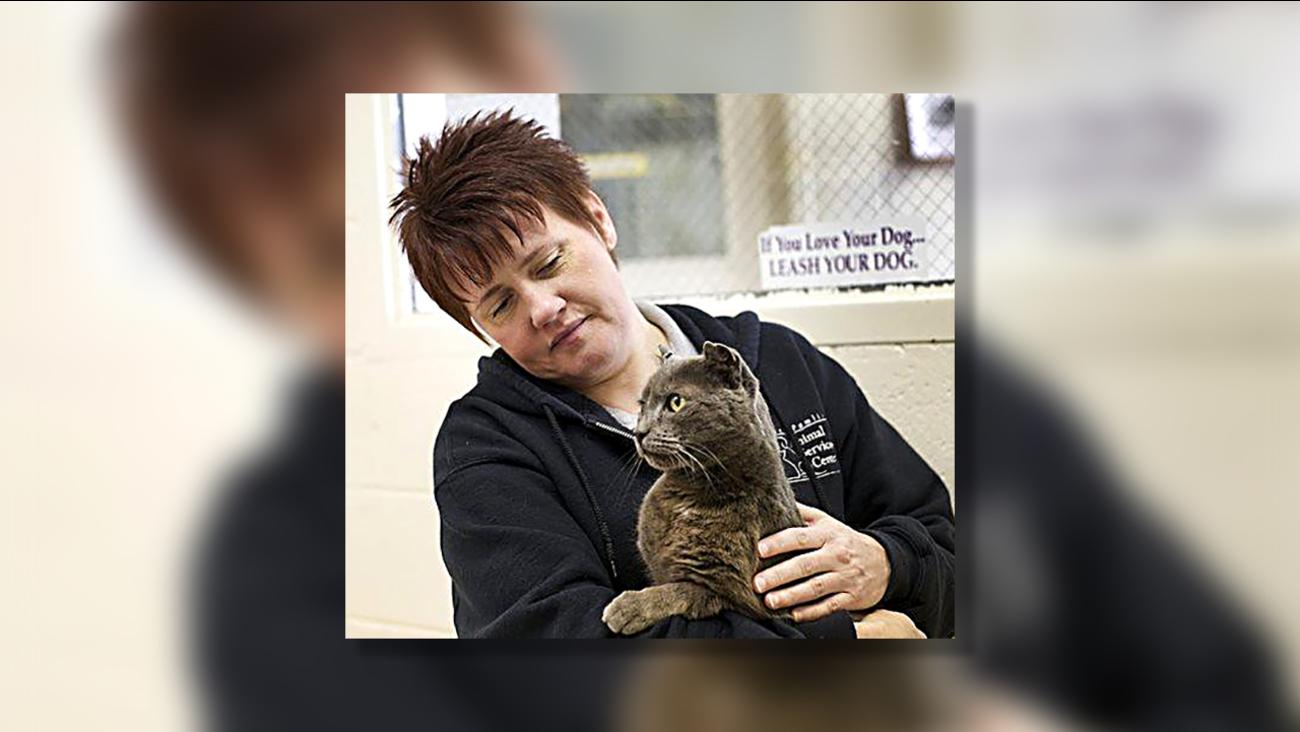 Craven County Animal Control Supervisor Trinity Smith holds Hemi in New Bern on Jan. 15.