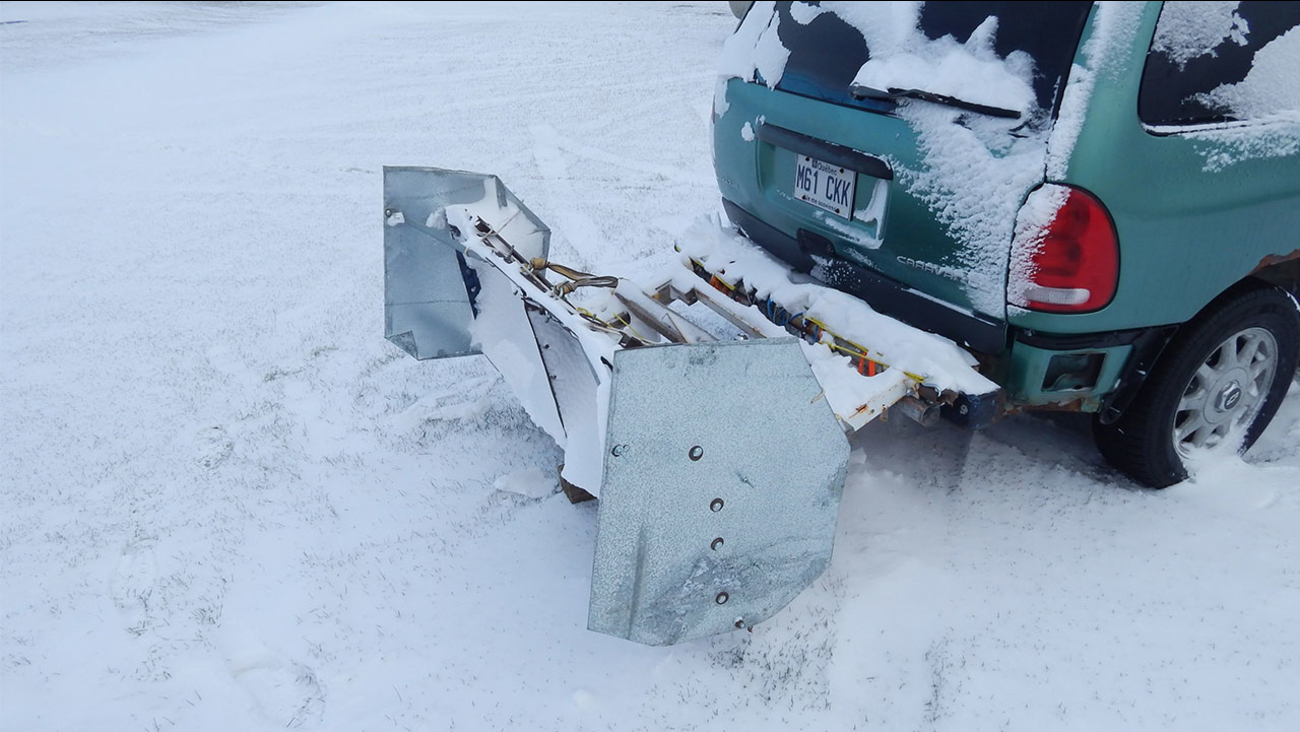 Canada man builds homemade snow plow to shovel his drive