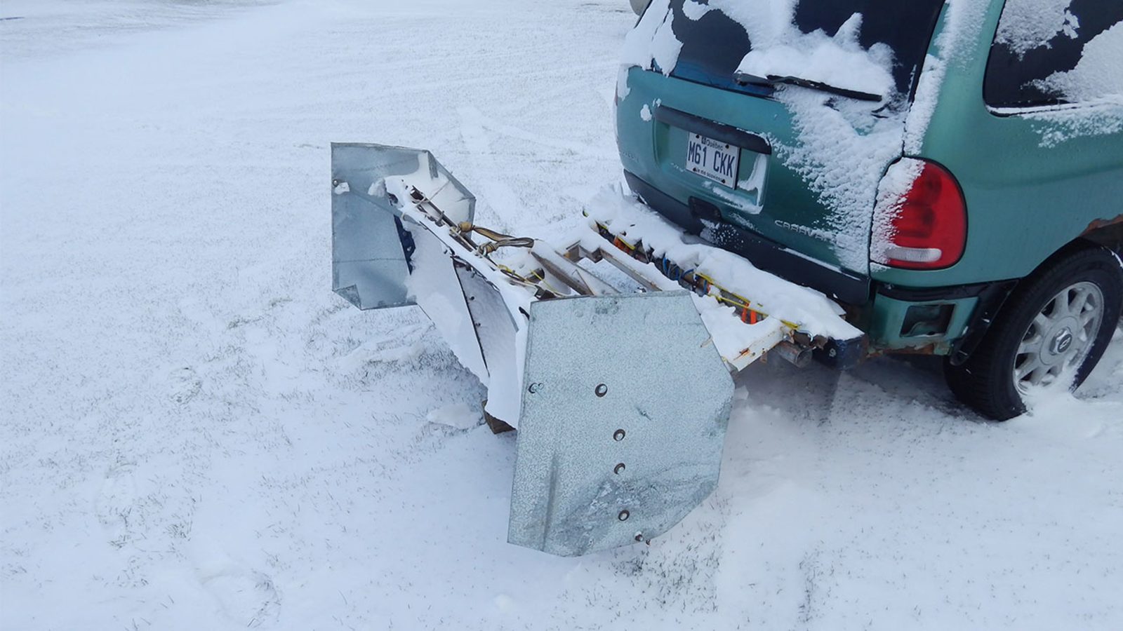 Canada man builds homemade snow plow to