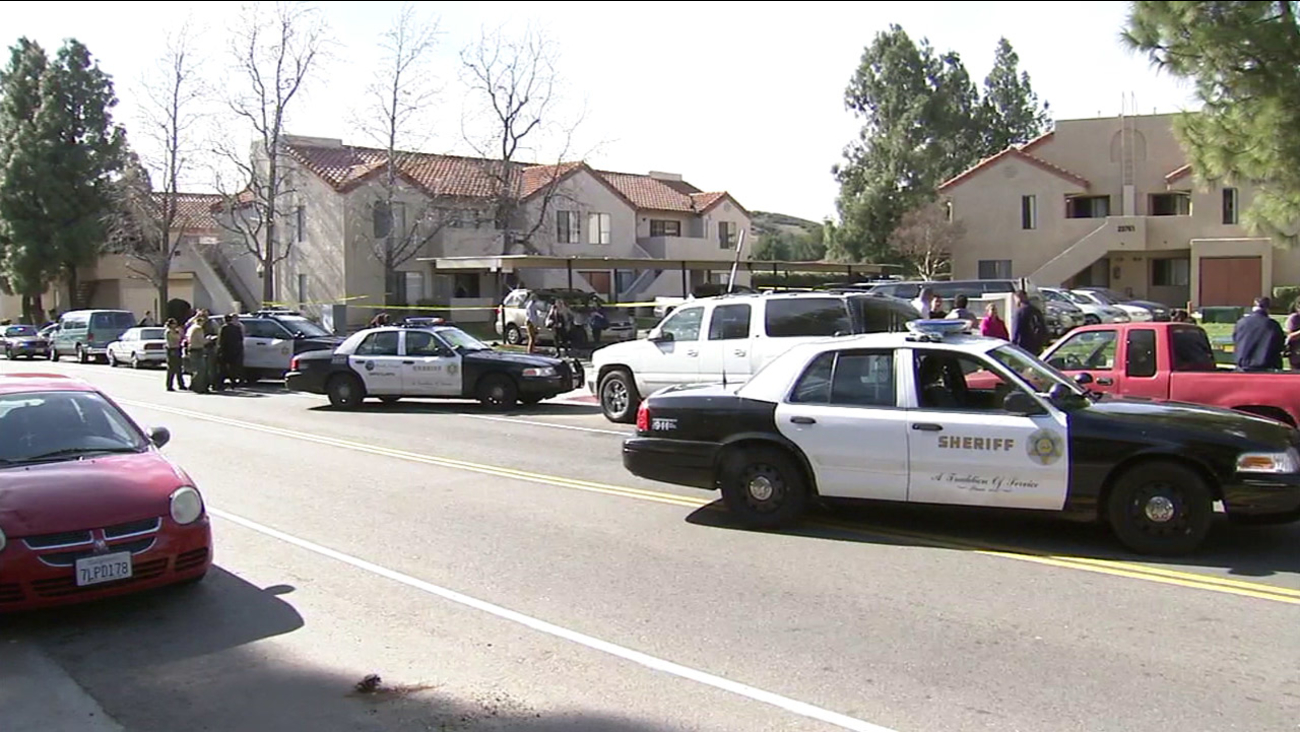 Authorities cordoned off the scene of a shooting after a man was killed near an apartment complex in Santa Clarita on Thursday, Jan. 21, 2016.