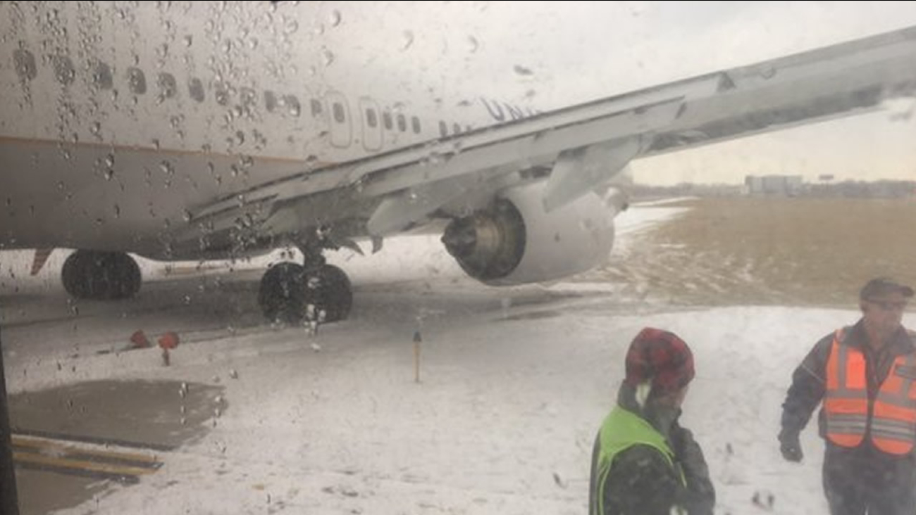 A plane slid off the runway at Chicago O'Hare International Airport on Friday, January 22, 2016.