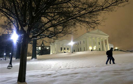 "<div class=""meta image-caption""><div class=""origin-logo origin-image none""><span>none</span></div><span class=""caption-text"">A couple walks past the snow covered grounds of the State Capitol in Richmond, Va., Friday, Jan. 22, 2016. (AP Photo/ Steve Helber)</span></div>"