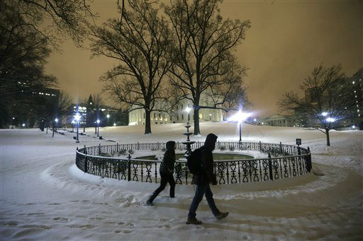 "<div class=""meta image-caption""><div class=""origin-logo origin-image none""><span>none</span></div><span class=""caption-text"">A couple walks past the fountain on the snow covered grounds of the State Capitol in Richmond, Va., Friday, Jan. 22, 2016. (AP Photo/ Steve Helber)</span></div>"