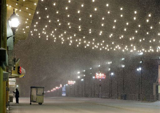 "<div class=""meta image-caption""><div class=""origin-logo origin-image none""><span>none</span></div><span class=""caption-text"">A stands near his Push cart during a snowstorm early Saturday, Jan. 23, 2016, on the Atlantic City Boardwalk. (AP Photo/ Mel Evans)</span></div>"