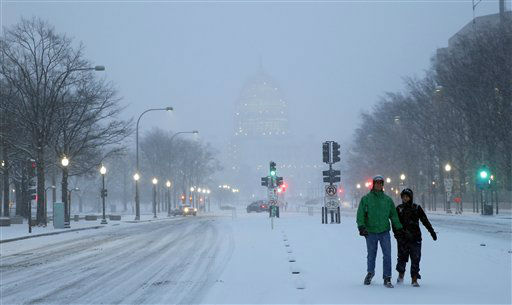 "<div class=""meta image-caption""><div class=""origin-logo origin-image none""><span>none</span></div><span class=""caption-text"">Madison Riley, left, and Katie Lantuh walk down the middle of Pennsylvania Avenue with the U.S. Capitol behind them, as the snow falls, Friday, Jan. 22, 2016 in Washington. (AP Photo/ Alex Brandon)</span></div>"