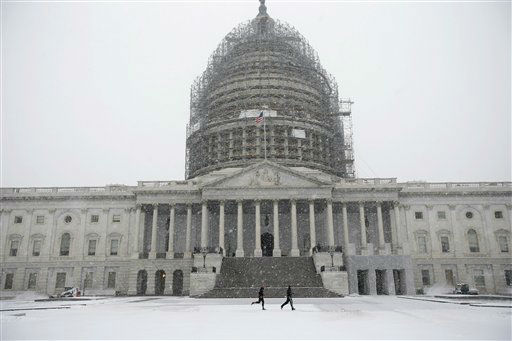 "<div class=""meta image-caption""><div class=""origin-logo origin-image none""><span>none</span></div><span class=""caption-text"">Two runners jog as the snow falls on Capitol Hill, Friday, Jan. 22, (AP Photo/ Alex Brandon)</span></div>"
