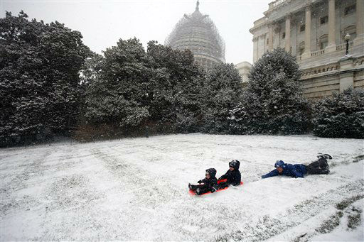"<div class=""meta image-caption""><div class=""origin-logo origin-image none""><span>none</span></div><span class=""caption-text"">Ben Cichy slips as he pushes his sons Adrian, 18 months, and Logan 3, as they sled in the snow on Capitol Hill, Friday, Jan. 22, 2016 in Washington. (AP Photo/ Alex Brandon)</span></div>"