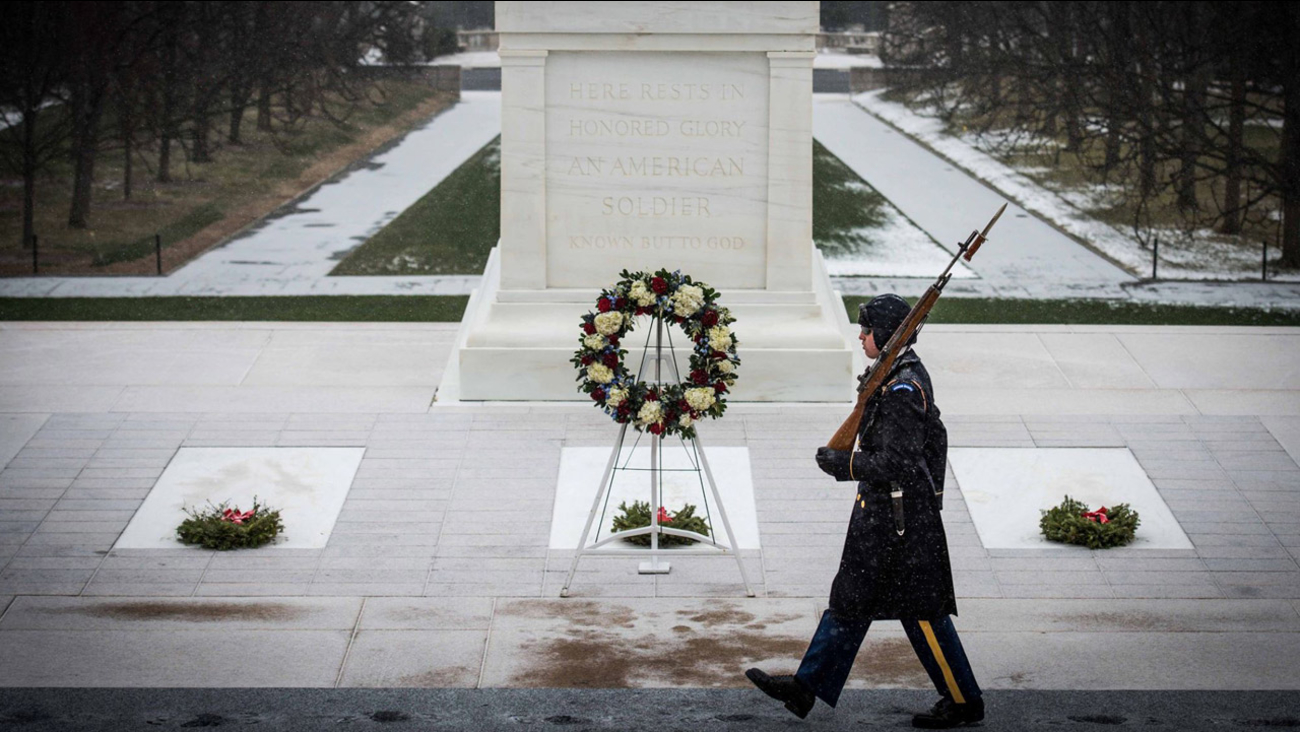 A Tomb Guard sentinel keeps watch over the Tomb of the Unknown Soldier despite freezing temperatures on Saturday, Jan. 23, 2016 in Arlington, Virginia.