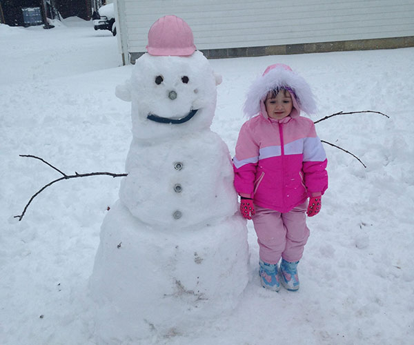 """<div class=""""meta image-caption""""><div class=""""origin-logo origin-image none""""><span>none</span></div><span class=""""caption-text"""">Maci stands proud with her """"Nuts and Bolts"""" snowman in Laurel Lake, New Jersey. (Amanda)</span></div>"""