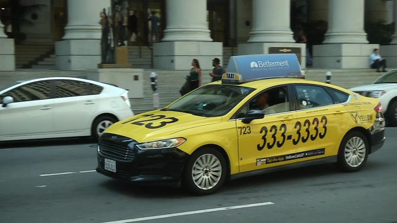 FILE: A Yellow Cab drives through San Francisco.