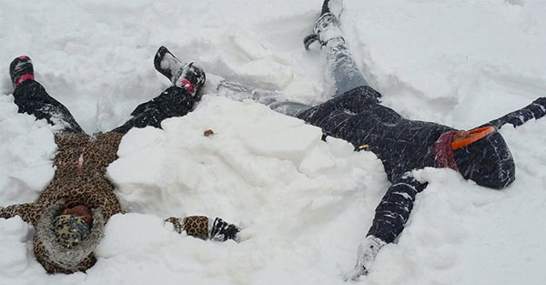 """<div class=""""meta image-caption""""><div class=""""origin-logo origin-image none""""><span>none</span></div><span class=""""caption-text"""">God sisters, 7-year-old Nzinga Collins and 19-year-old Nijiyyah Campbell, make snow angels outside their Upper Darby home. (Denise James News)</span></div>"""