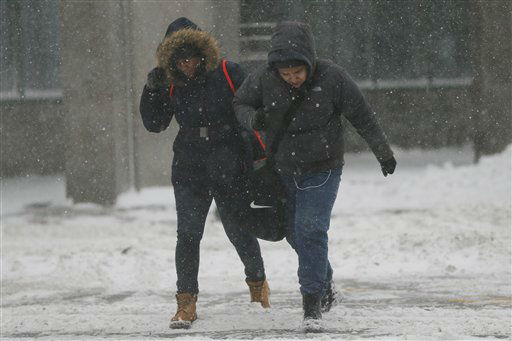"<div class=""meta image-caption""><div class=""origin-logo origin-image none""><span>none</span></div><span class=""caption-text"">People walk on a snow-covered intersection during a snowstorm, Saturday, Jan. 23, 2016, in Jersey City, N.J. (AP Photo/ Julio Cortez)</span></div>"