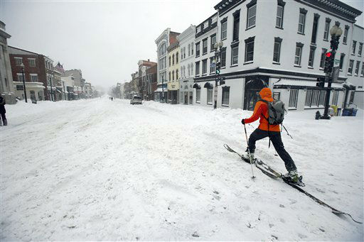 "<div class=""meta image-caption""><div class=""origin-logo origin-image none""><span>none</span></div><span class=""caption-text"">A man uses cross country skies as he goes down M Street NW in the snow, Saturday, Jan. 23, 2016 in the Georgetown area of Washington. (AP Photo/ Alex Brandon)</span></div>"