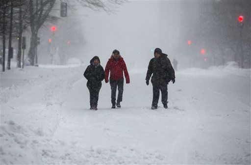 "<div class=""meta image-caption""><div class=""origin-logo origin-image none""><span>none</span></div><span class=""caption-text"">People walk on snow-covered streets in downtown Washington on Saturday, Jan. 23, 2016. (AP Photo/ Jon Elswick)</span></div>"