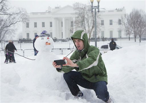 "<div class=""meta image-caption""><div class=""origin-logo origin-image none""><span>none</span></div><span class=""caption-text"">Harrison Feind of Boulder, Colo., takes a selfie with a snowman in front of the White House in Washington, Saturday, Jan. 23, 2016. (AP Photo/ Manuel Balce Ceneta)</span></div>"