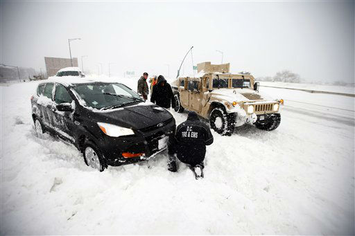 "<div class=""meta image-caption""><div class=""origin-logo origin-image none""><span>none</span></div><span class=""caption-text"">Soldiers with the 275th Military Police company, and a Washington Firefighter, in a Humvee, assist a stranded motorist in the snow on I-395, Saturday, Jan. 23, 2016 in Washington. (AP Photo/ Alex Brandon)</span></div>"