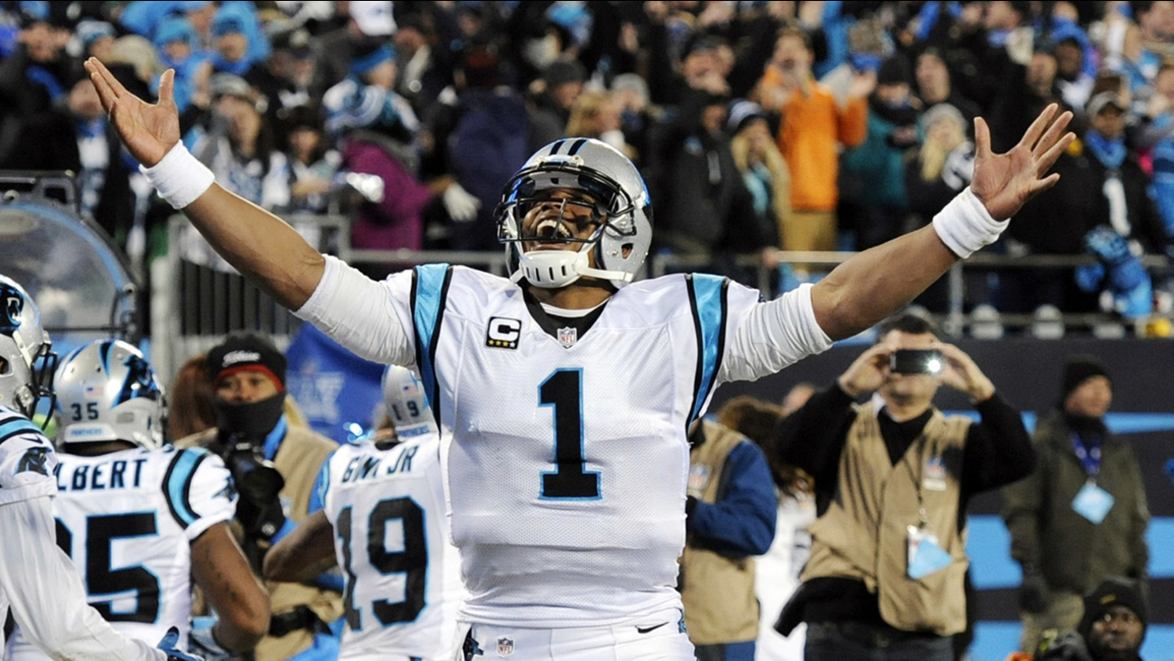 Carolina Panthers' Cam Newton celebrates his touchdown run during the second half the NFL football NFC Championship game against the Arizona Cardinals, Sunday