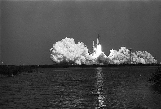 "<div class=""meta image-caption""><div class=""origin-logo origin-image none""><span>none</span></div><span class=""caption-text"">After creating a huge cloud of smoke the Space Shuttle Challenger lifts off from the Kennedy Space Center (AP Photo/ IP MN, GP. KEY S, RO. XMEH)</span></div>"