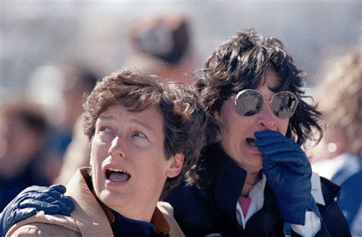<div class='meta'><div class='origin-logo' data-origin='none'></div><span class='caption-text' data-credit='AP Photo/ PS'>In this Jan. 28, 1986 picture, two unidentified spectators at the Kennedy Space Center</span></div>