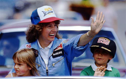 <div class='meta'><div class='origin-logo' data-origin='none'></div><span class='caption-text' data-credit='AP Photo/ Jim Cole'>In this 1985 photo, high school teacher Christa McAuliffe rides with her children Caroline, left, and Scott during a parade down Main Street in Concord, N.H.</span></div>