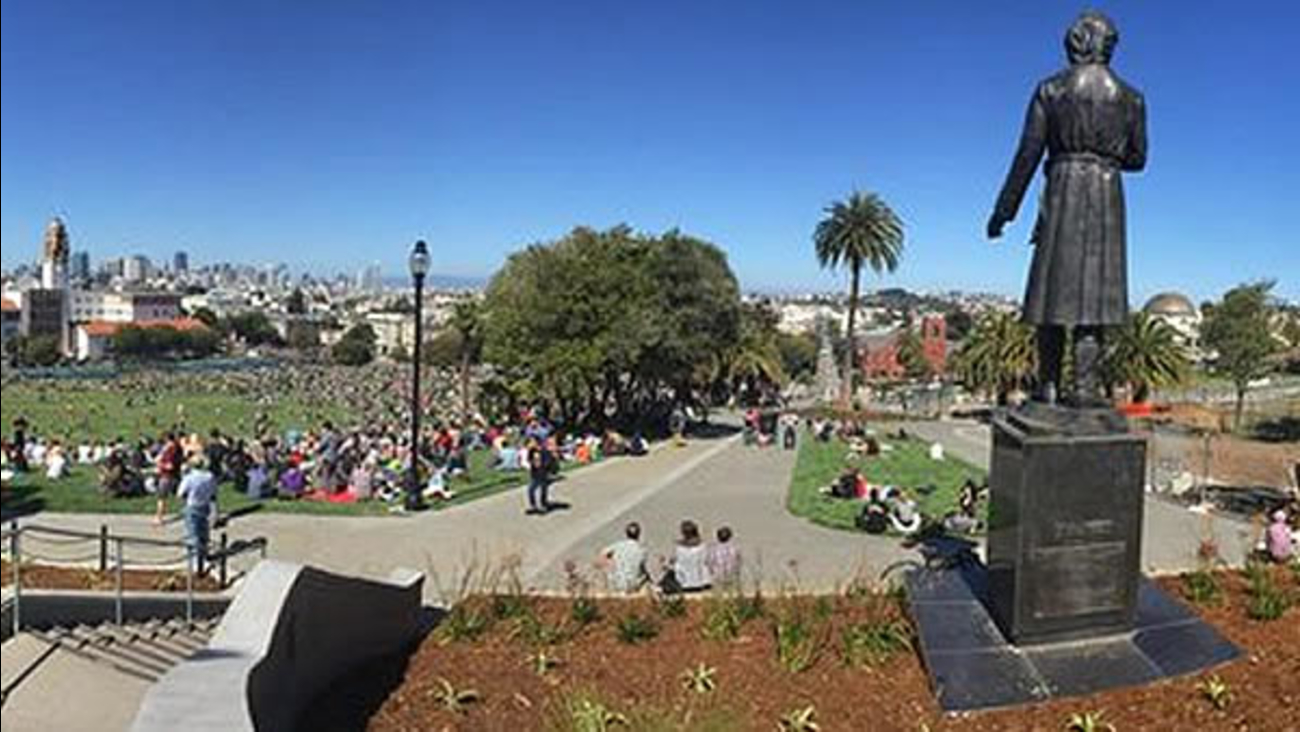 A crowd sits on the grass at Dolores Park in San Francisco, Calif. on Sunday, June 21, 2015.