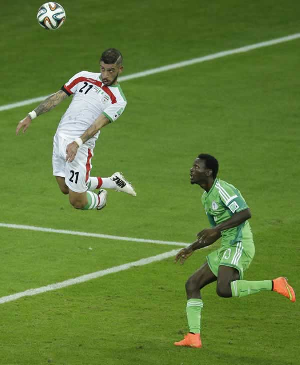 "<div class=""meta image-caption""><div class=""origin-logo origin-image ""><span></span></div><span class=""caption-text"">Iran's Ashkan Dejagah heads a ball as Nigeria's Juwon Oshaniwa, right, looks on during the group F World Cup soccer match between Iran and Nigeria. (AP Photo/Michael Sohn)</span></div>"