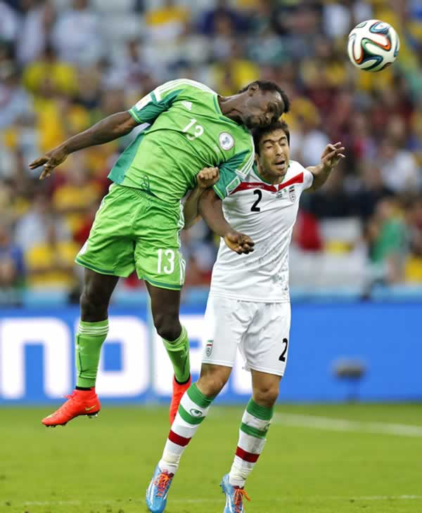 "<div class=""meta image-caption""><div class=""origin-logo origin-image ""><span></span></div><span class=""caption-text"">Nigeria's Juwon Oshaniwa heads the ball past Iran's Khosro Heydari during the group F World Cup soccer match between Iran and Nigeria. (AP Photo/Frank Augstein)</span></div>"