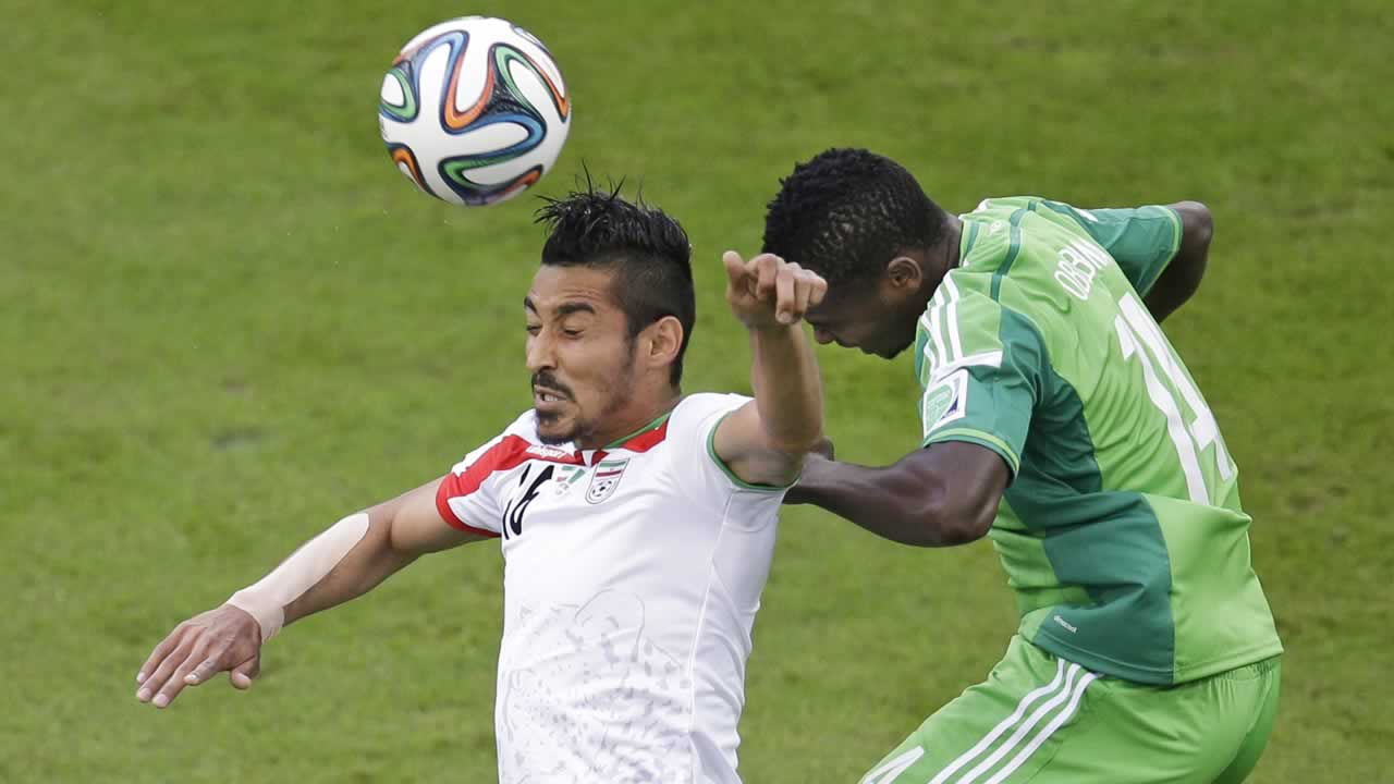 "<div class=""meta image-caption""><div class=""origin-logo origin-image ""><span></span></div><span class=""caption-text"">Iran's Reza Ghoochannejhad, left, and Nigeria's Godfrey Oboabona go for a header during the group F World Cup soccer match between Iran and Nigeria. (AP Photo/Michael Sohn)</span></div>"