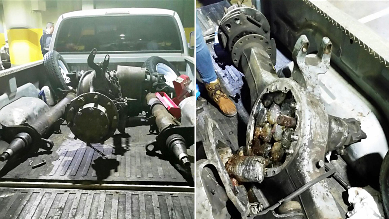 One of the trucks seized, left, and the heroin bundled inside the axle and the drive shaft casings.