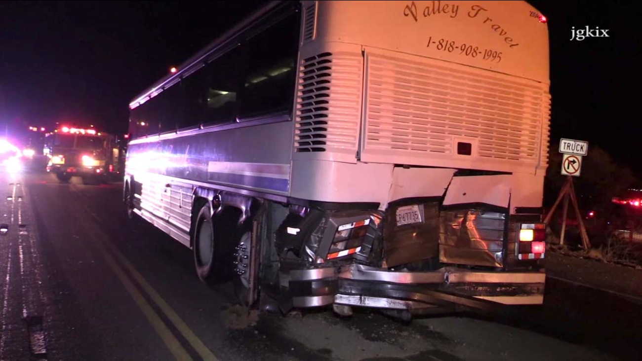 A pickup truck rear-ended a charter bus on the 138 Freeway in Phelan on Wednesday, Jan. 27, 2016.
