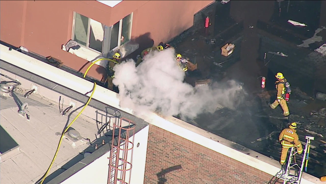 Firefighters with the Los Angeles Fire Department extinguish a fire following an explosion at an apartment building on South Hewitt Street on Thursday, Jan. 28, 2016.