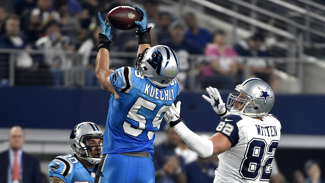 Luke Kuechly takes this interception back for a touchdown against Dallas on Thursday, Nov. 26, 2015.