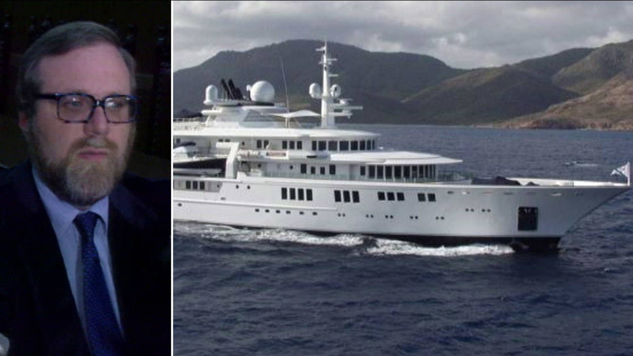 Paul Allen is shown in an undated photo alongside an image of his 300-foot yacht.