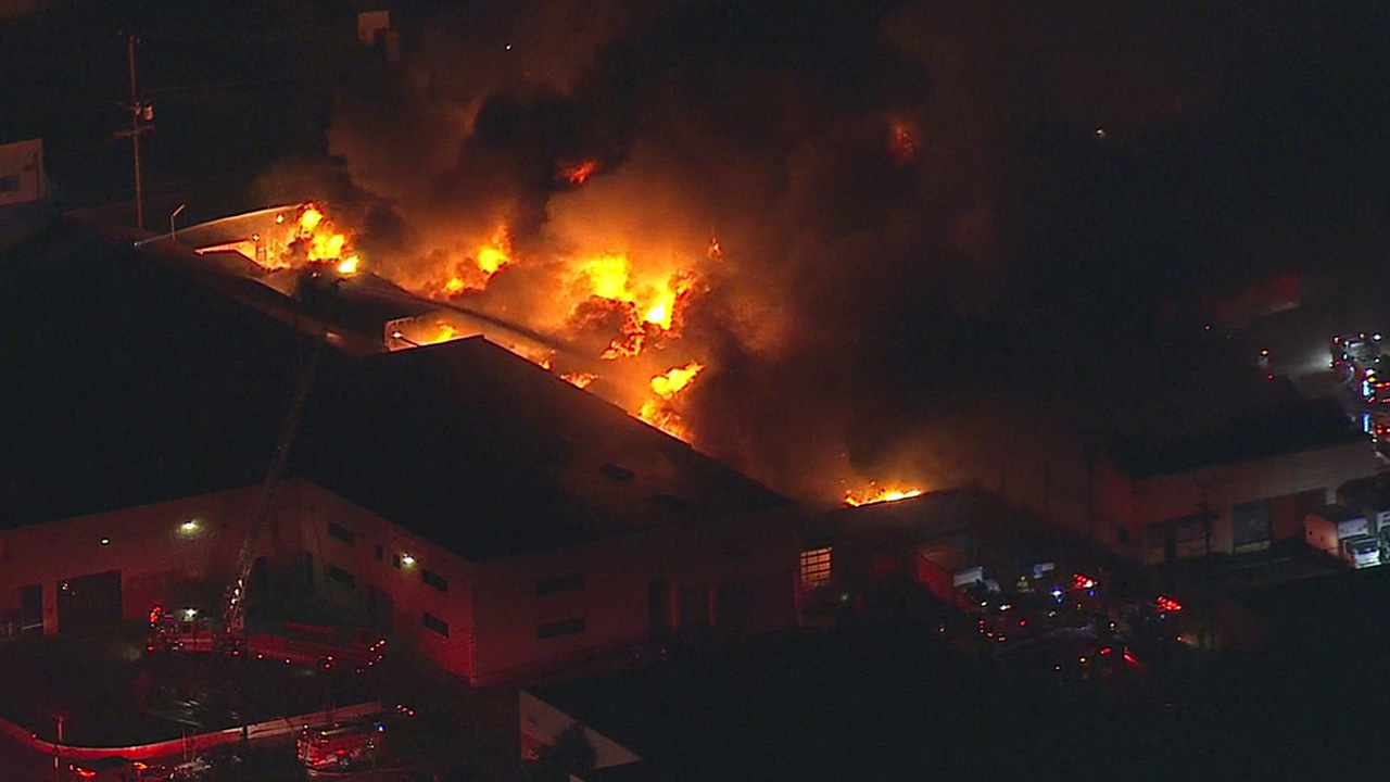 Los Angeles firefighters respond to a massive fire at a commercial building in the 3000 block of N. Fierro Street in Glassell Park Monday, Feb. 1, 2016.