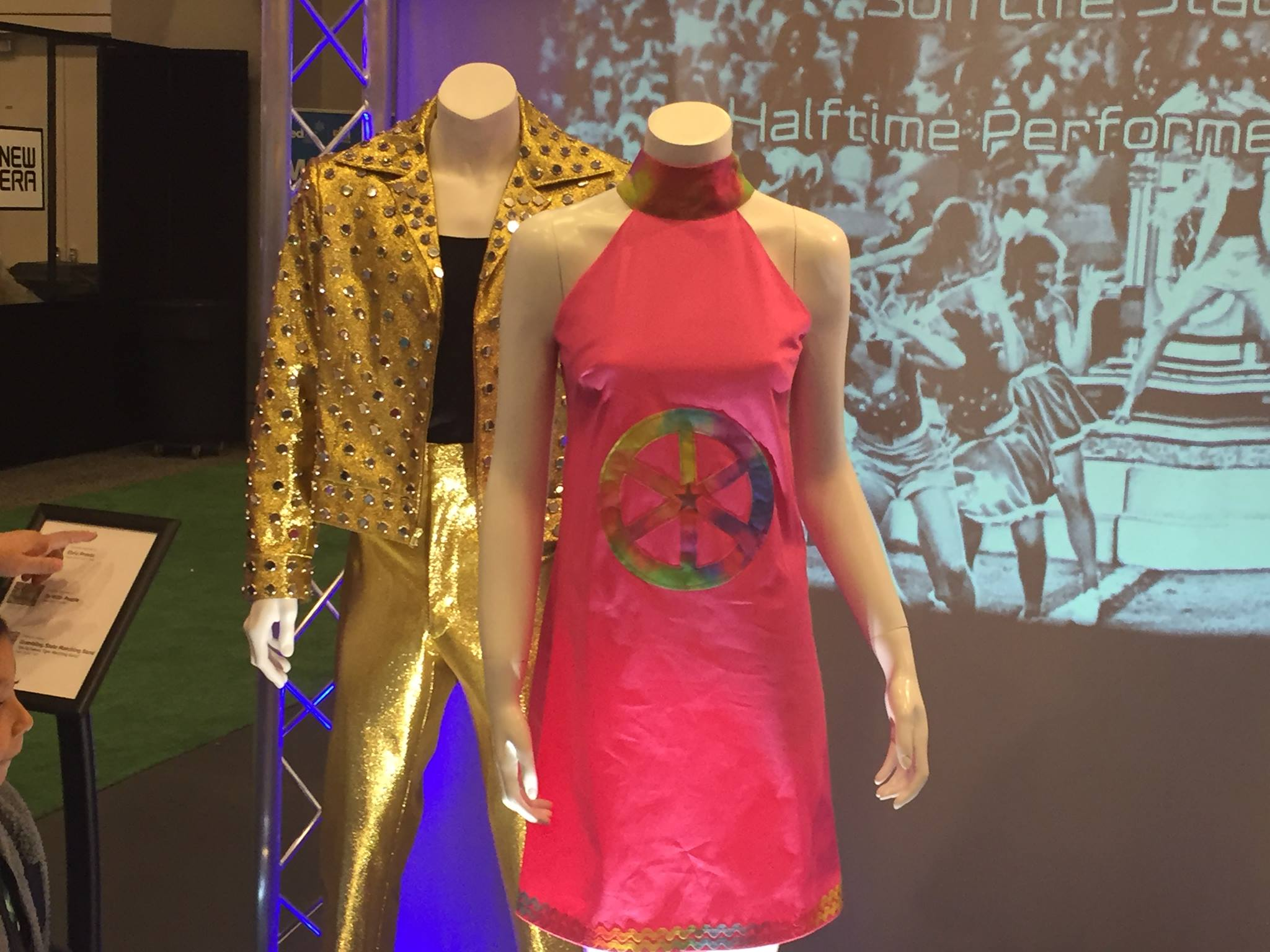 "<div class=""meta image-caption""><div class=""origin-logo origin-image none""><span>none</span></div><span class=""caption-text"">Outfits inspired by Super Bowl halftime acts ""Elvis Presto"" and ""Up With People,"" as seen at NFL Experience, Sunday, January 31, 2016. (KGO-TV)</span></div>"