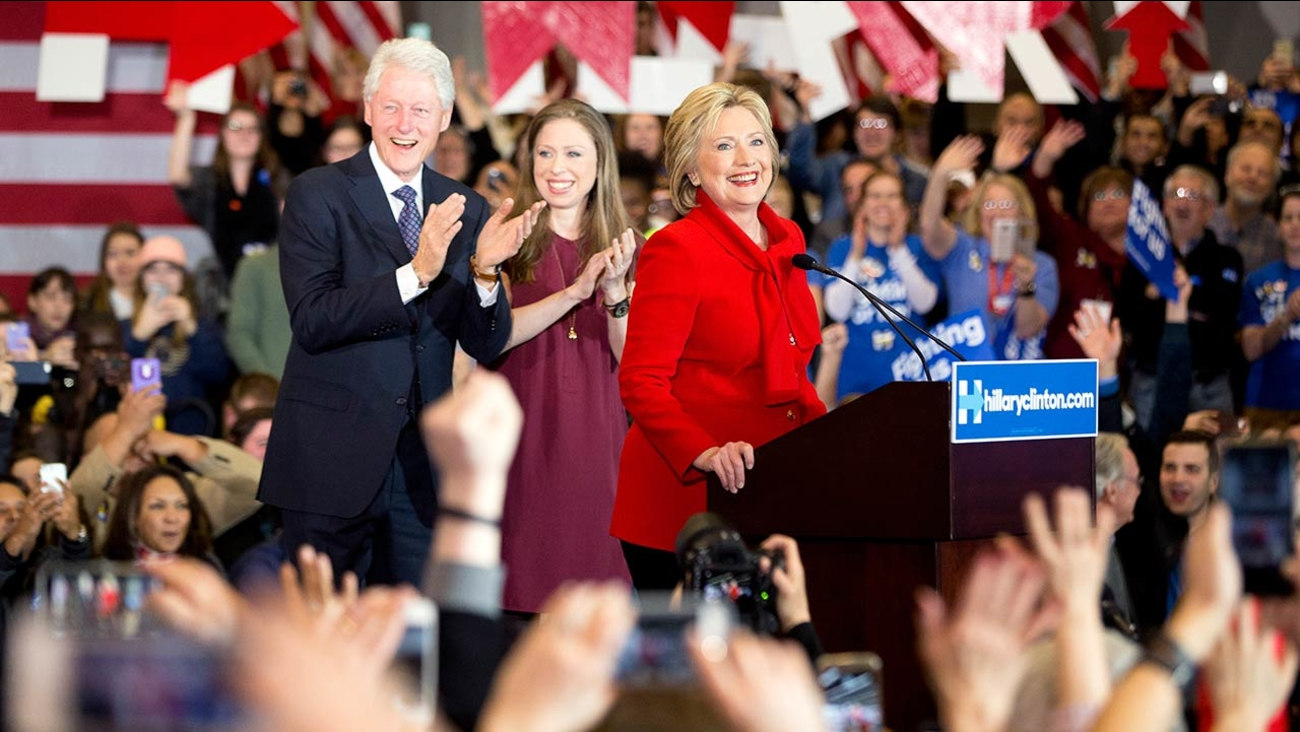Hillary Clinton, accompanied by former President Bill Clinton and their daughter Chelsea Clinton speaks at her caucus night rally in Iowa, Monday, Feb. 1, 2016.