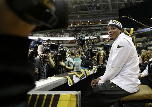 """<div class=""""meta image-caption""""><div class=""""origin-logo origin-image none""""><span>none</span></div><span class=""""caption-text"""">Carolina Panthers' Cam Newton answers a question during Opening Night for the NFL Super Bowl 50 football game Monday, Feb. 1, 2016, in San Jose, Calif. (AP/David J. Phillip)</span></div>"""
