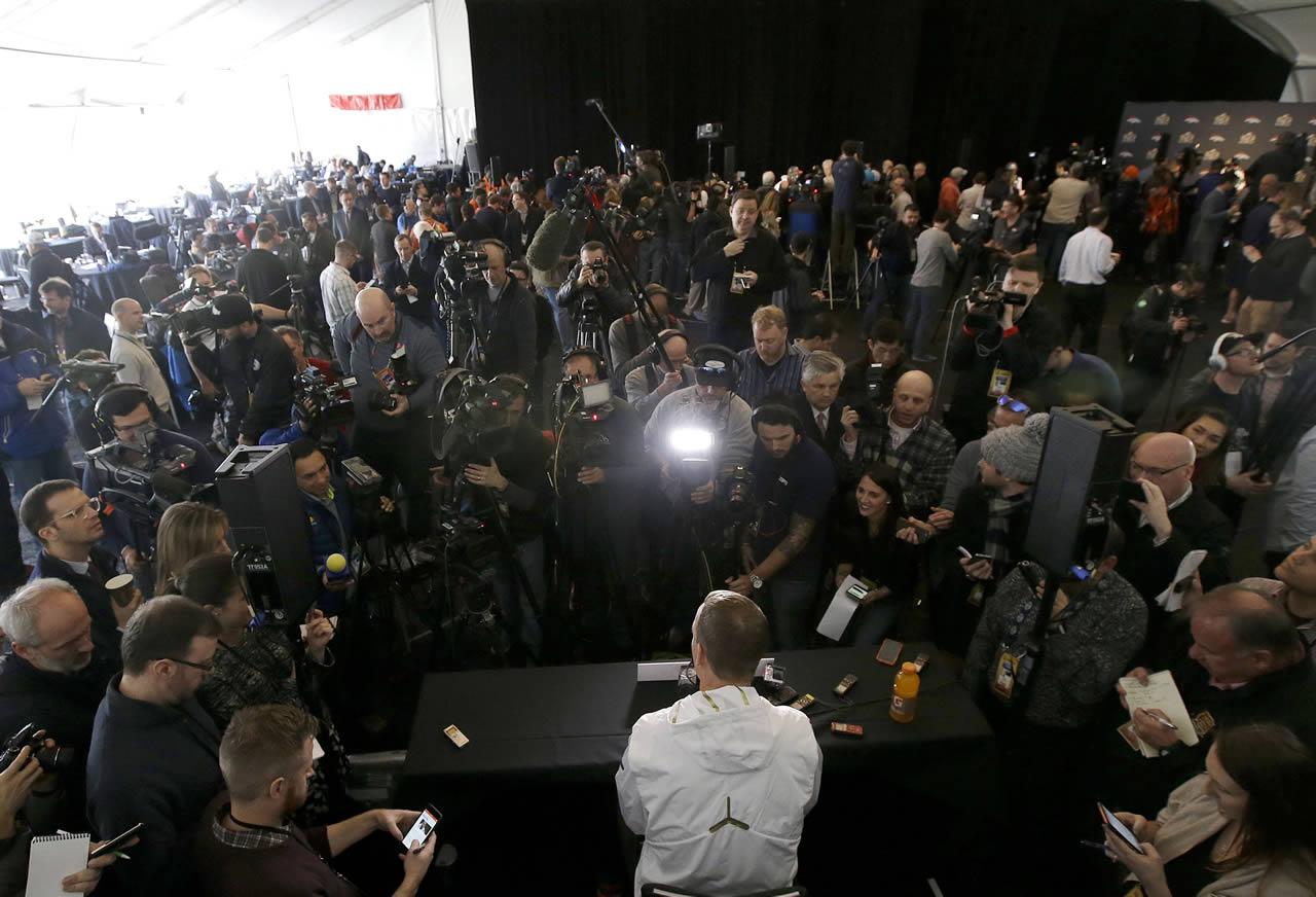 """<div class=""""meta image-caption""""><div class=""""origin-logo origin-image none""""><span>none</span></div><span class=""""caption-text"""">Denver Broncos quarterback Peyton Manning, bottom center, speaks to reporters in Santa Clara, Calif., Tuesday, Feb. 2, 2016. (AP/Jeff Chiu)</span></div>"""