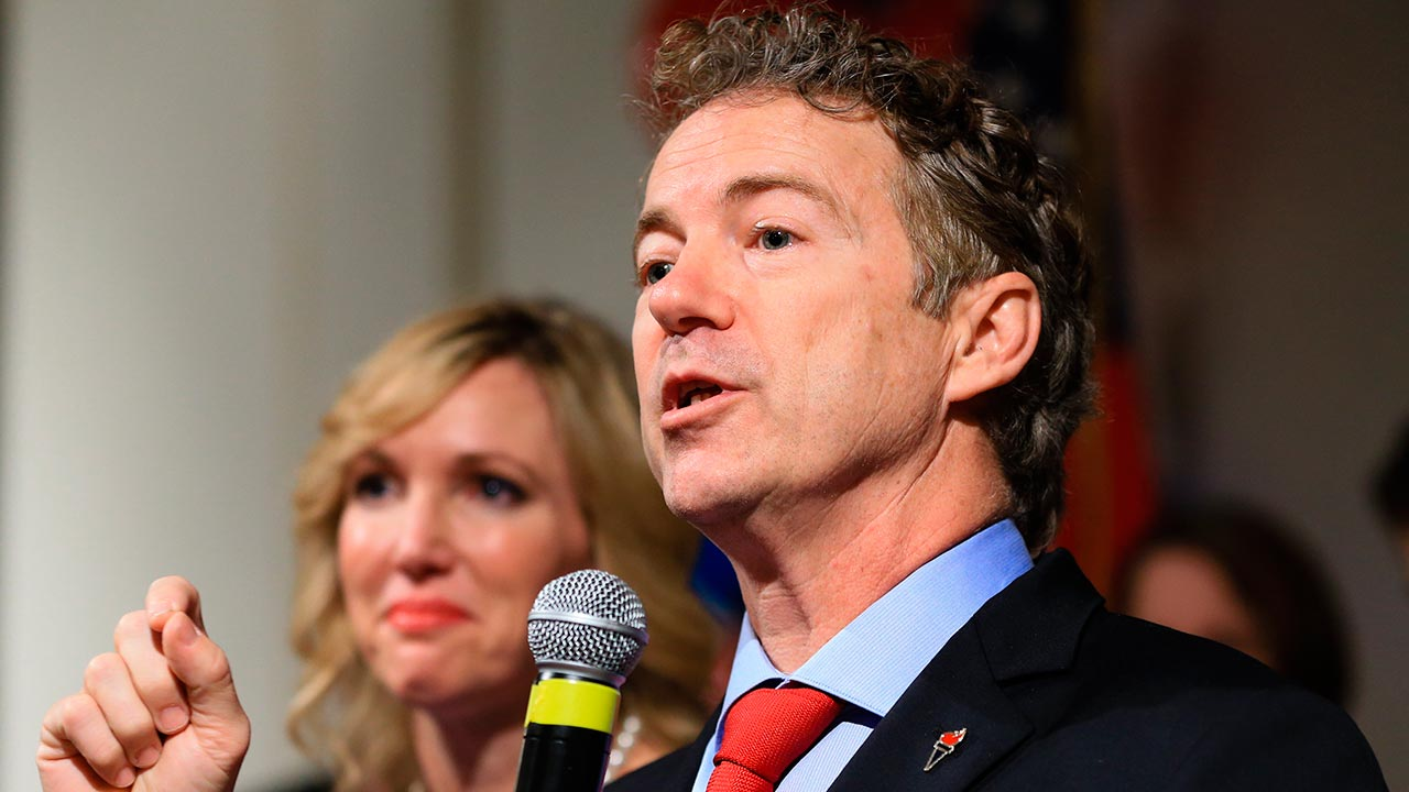 Republican presidential candidate, Sen. Rand Paul, R-Ky, speaks to supporters with his wife Kelley by his side, during a caucus night victory party at the Scottish Rite Consistory