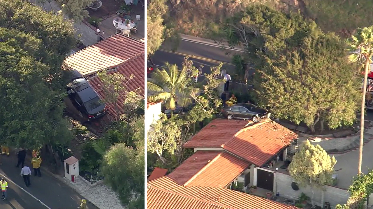 A car crashed into the roof of a two-story home in the 500 block Palos Verdes Drive West in Palos Verdes Estates on Wednesday, Feb. 3, 2016.