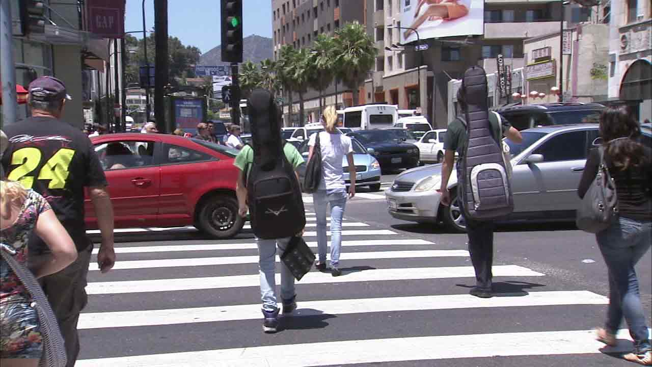 An undated file photo shows pedestrians crossing a busy street in Los Angeles.