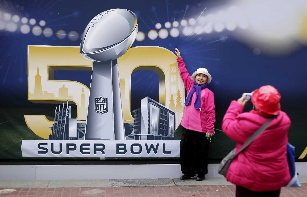 "<div class=""meta image-caption""><div class=""origin-logo origin-image none""><span>none</span></div><span class=""caption-text"">Angie Bagares poses for a photo in front of a Super Bowl 50 sign at Super Bowl City Wednesday, Feb. 3, 2016, in San Francisco. (AP Photo/Charlie Riedel)</span></div>"