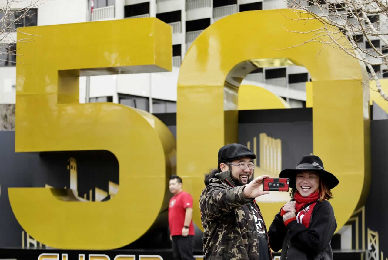 "<div class=""meta image-caption""><div class=""origin-logo origin-image none""><span>none</span></div><span class=""caption-text"">Carissa Lou and Marc Shimamoto pose for a selfie in front of a Super Bowl 50 sign at Super Bowl City Wednesday, Feb. 3, 2016, in San Francisco. (AP Photo/Charlie Riedel)</span></div>"